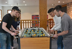 A round of foosball for old time's sake on Young Alumni Day.