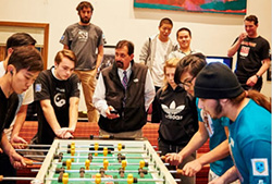 Head of School Tom Wilschutz keeps time during  our annual foosball tournament.
